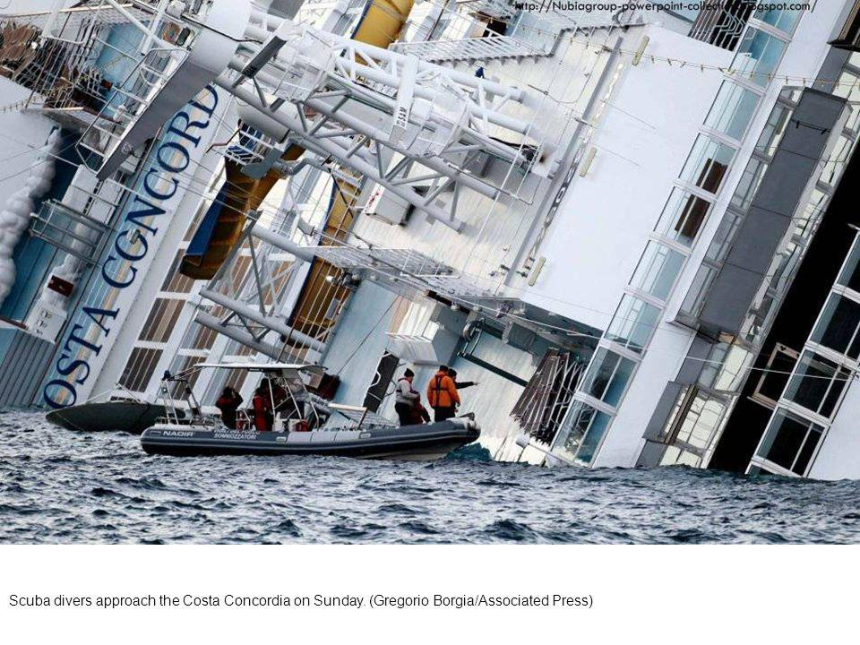 Divers approach the Costa Concordia on Sunday. (Gregorio Borgia/Associated Press