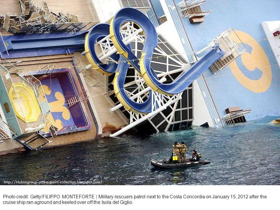 italian firefighters scuba divers approach the luxury cruise ship Costa Concordia which ran aground off the tiny Tuscan island of Giglio, Italy.