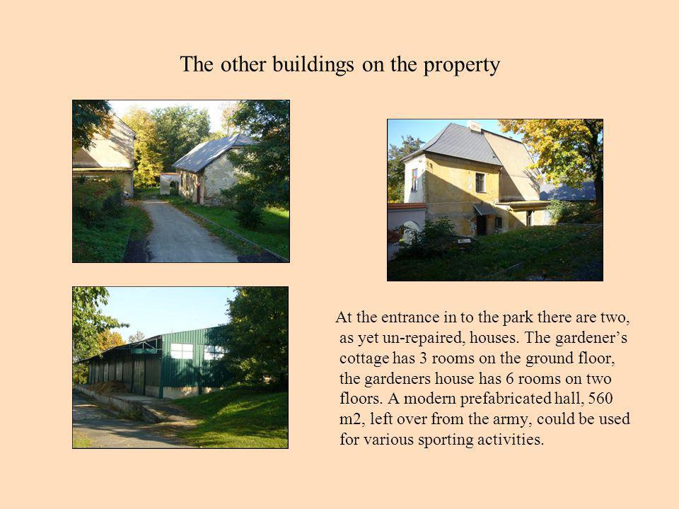 The other buildings on the property At the entrance in to the park there are two, as yet un-repaired, houses.