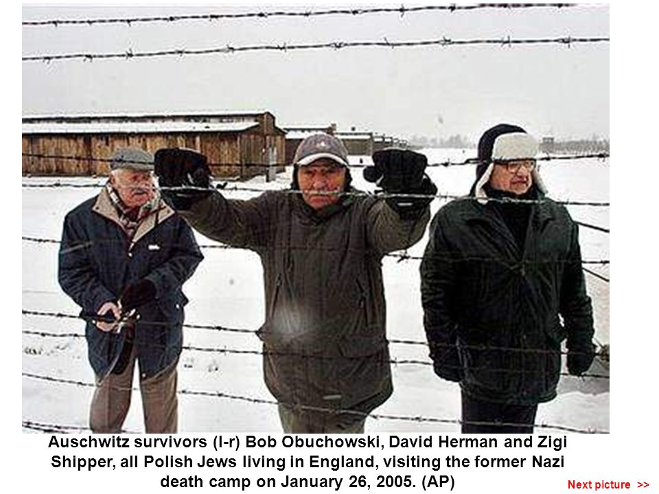 Auschwitz survivor Michal Ziolkowski walking out of the main gate at the Auschwitz museum, near the former Nazi death camp, on January 26, 2005.