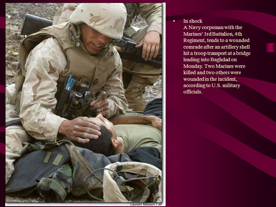 In shock A Navy corpsman with the Marines' 3rd Battalion, 4th Regiment, tends to a wounded comrade after an artillery shell hit a troop transport at a