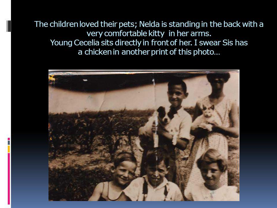 The children loved their pets; Nelda is standing in the back with a very comfortable kitty in her arms. Young Cecelia sits directly in front of her. I