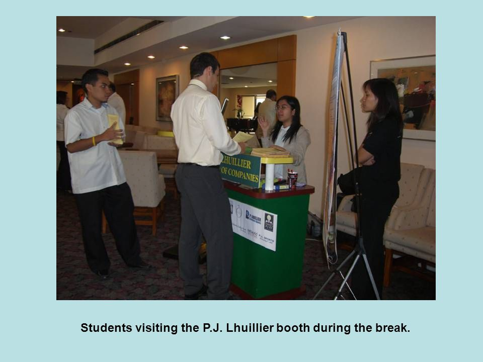 Students visiting the P.J. Lhuillier booth during the break.
