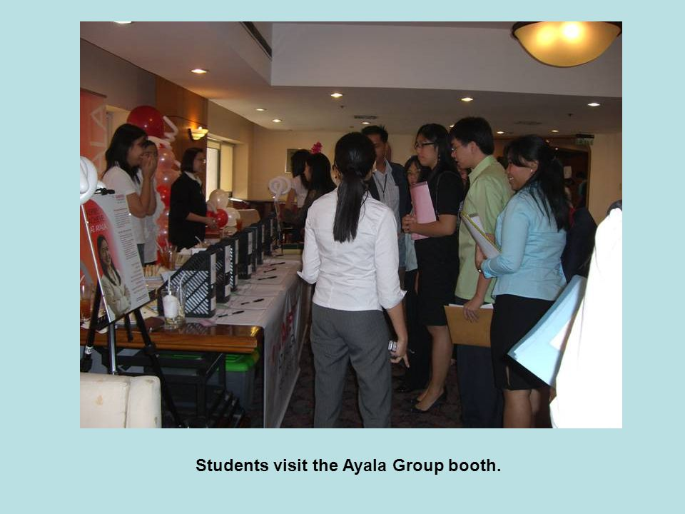 Students visit the Ayala Group booth.