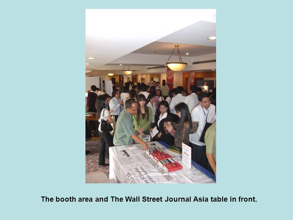 The booth area and The Wall Street Journal Asia table in front.