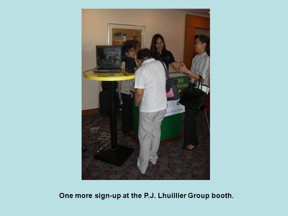 One more sign-up at the P.J. Lhuillier Group booth.