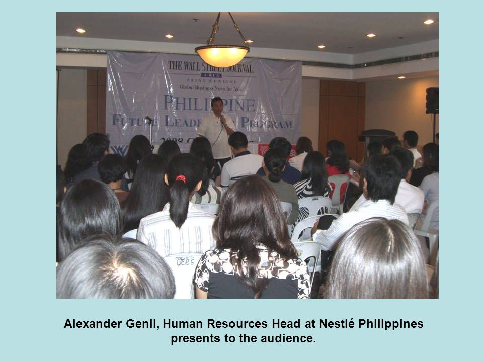 Alexander Genil, Human Resources Head at Nestlé Philippines presents to the audience.