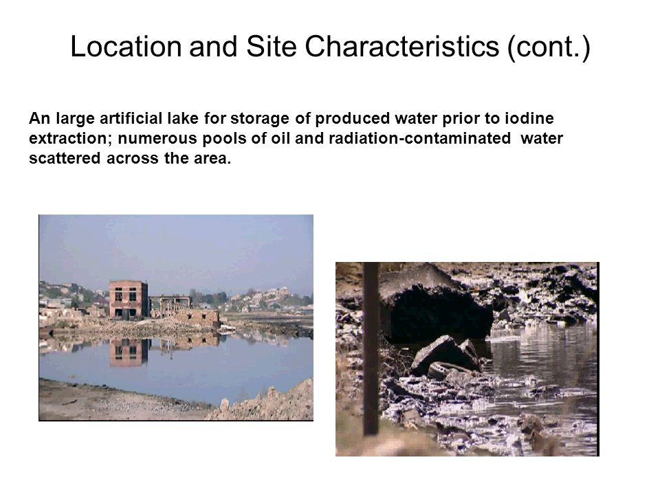 An large artificial lake for storage of produced water prior to iodine extraction; numerous pools of oil and radiation-contaminated water scattered across the area.