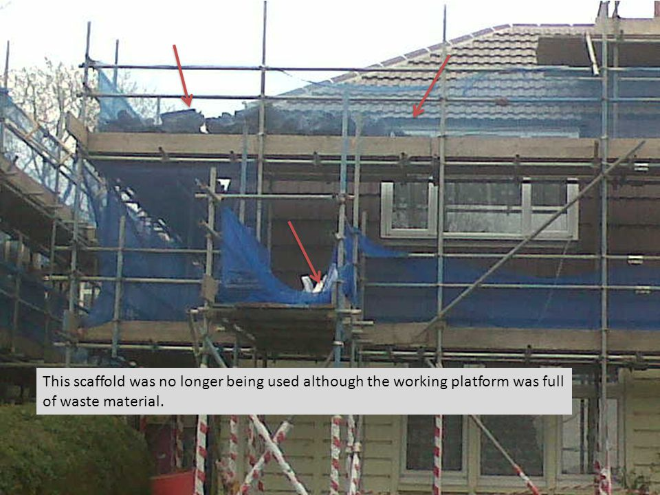 This scaffold was no longer being used although the working platform was full of waste material.