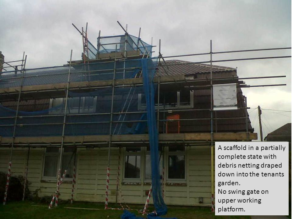 A scaffold in a partially complete state with debris netting draped down into the tenants garden.