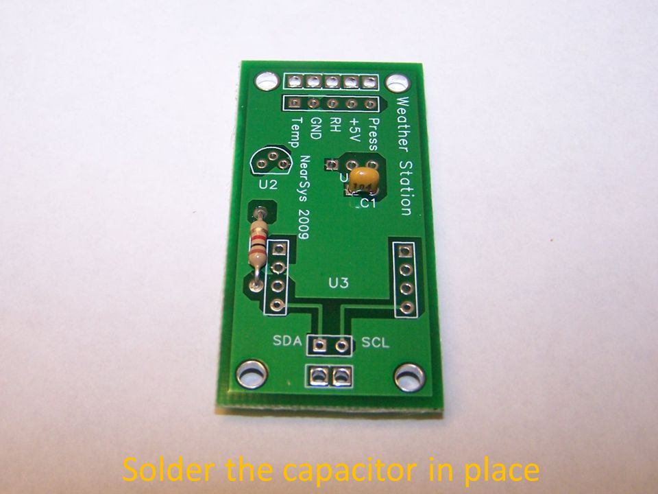 Solder the capacitor in place