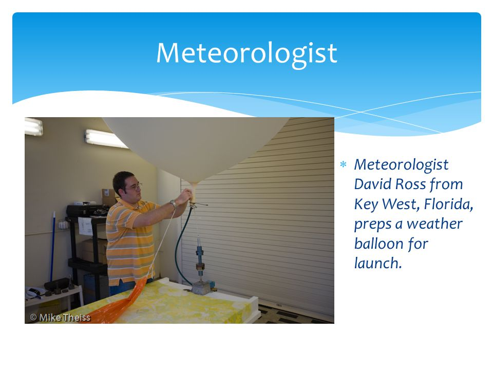 Meteorologist David Ross from Key West, Florida, preps a weather balloon for launch. Meteorologist