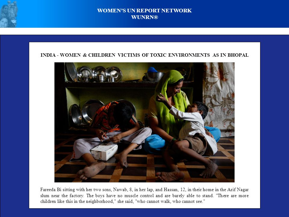 WOMENS UN REPORT NETWORK WUNRN® INDIA - WOMEN & CHILDREN VICTIMS OF TOXIC ENVIRONMENTS AS IN BHOPAL Fareeda Bi sitting with her two sons, Nawab, 8, in her lap, and Hassan, 12, in their home in the Arif Nagar slum near the factory.