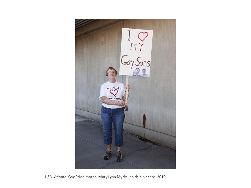USA. Atlanta. Gay Pride march. Mary Lynn Myrkel holds a placard. 2010.