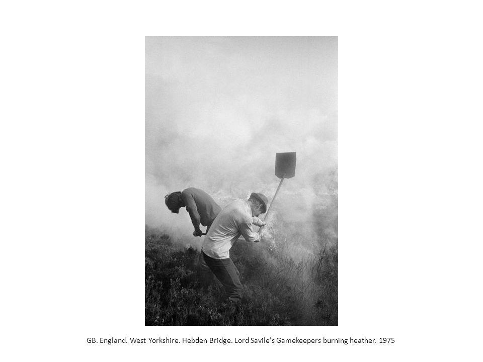 GB. England. West Yorkshire. Hebden Bridge. Lord Savile's Gamekeepers burning heather. 1975
