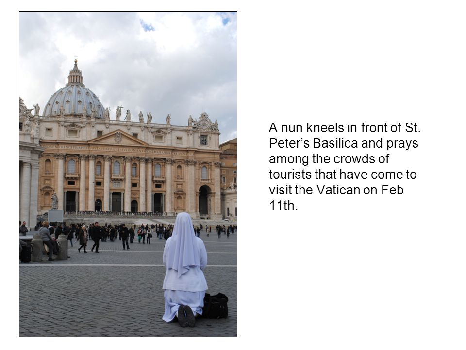 A nun kneels in front of St.