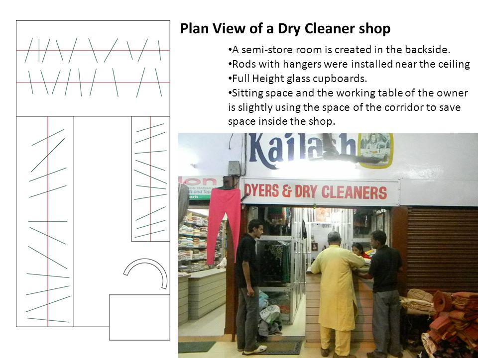 Plan View of a Dry Cleaner shop A semi-store room is created in the backside. Rods with hangers were installed near the ceiling Full Height glass cupb