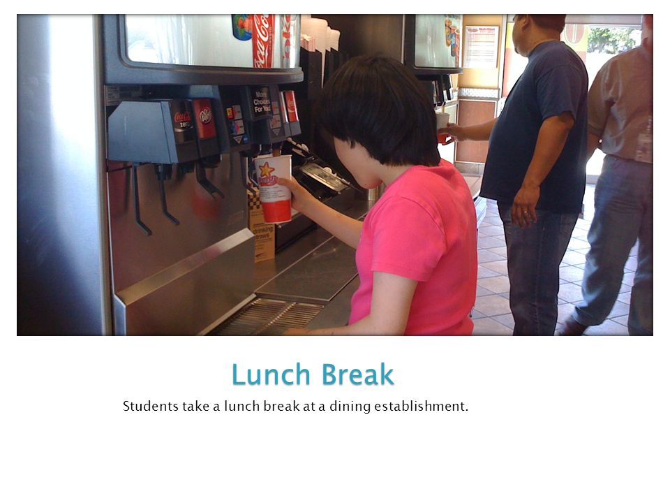 Students take a lunch break at a dining establishment. Lunch Break