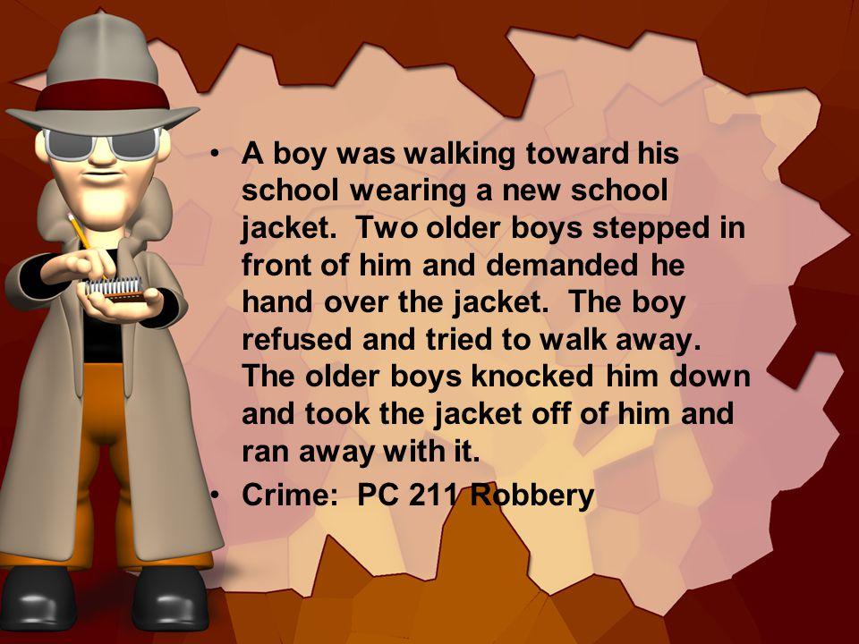 A boy was walking toward his school wearing a new school jacket.