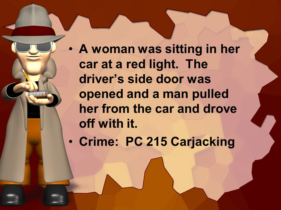 A woman was sitting in her car at a red light.