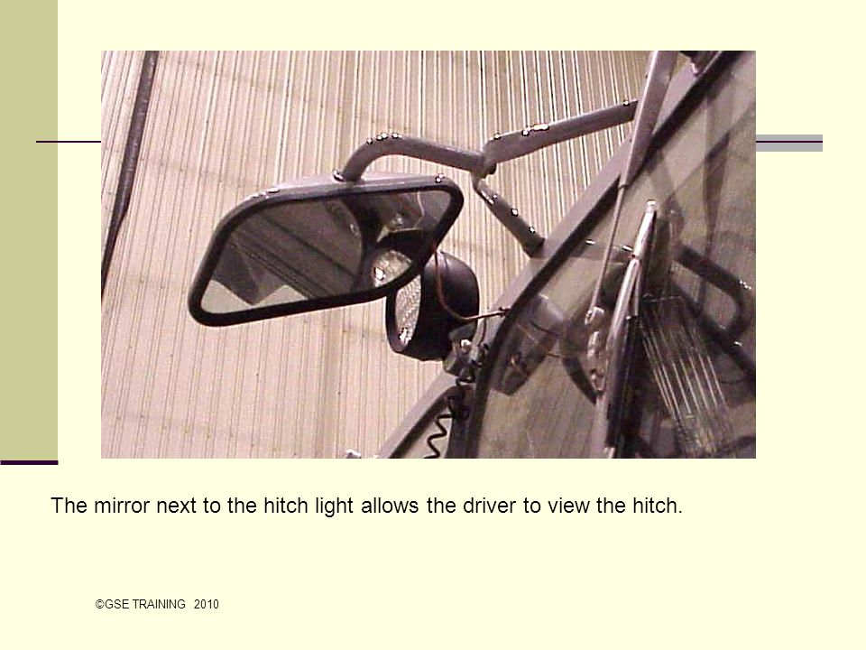 The mirror next to the hitch light allows the driver to view the hitch. ©GSE TRAINING 2010