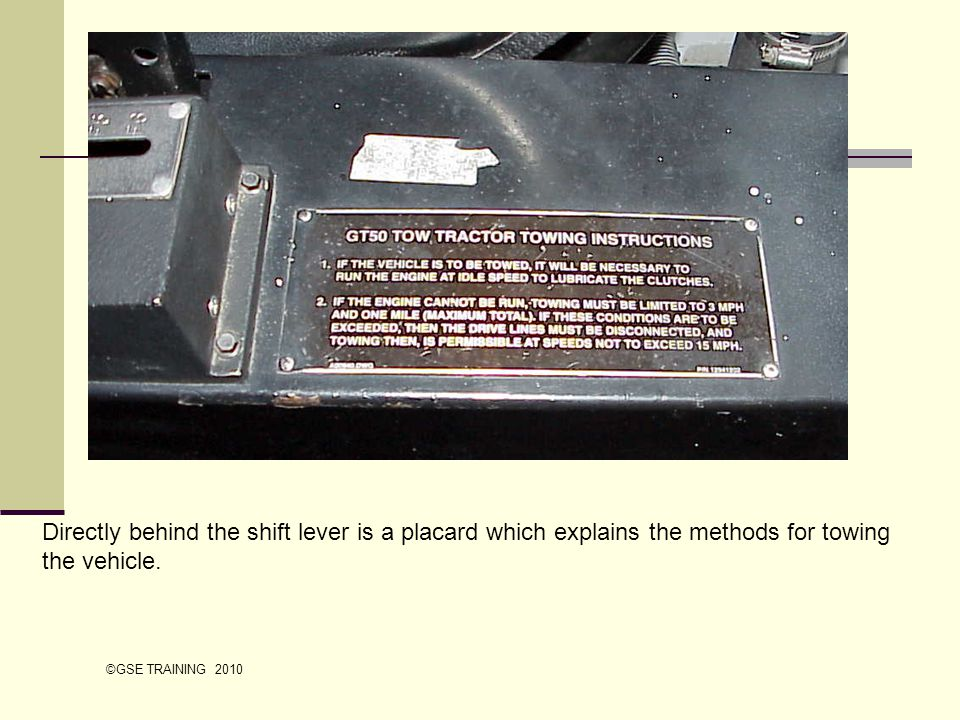 Directly behind the shift lever is a placard which explains the methods for towing the vehicle. ©GSE TRAINING 2010