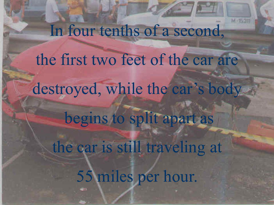In four tenths of a second, the first two feet of the car are destroyed, while the cars body begins to split apart as the car is still traveling at 55 miles per hour.