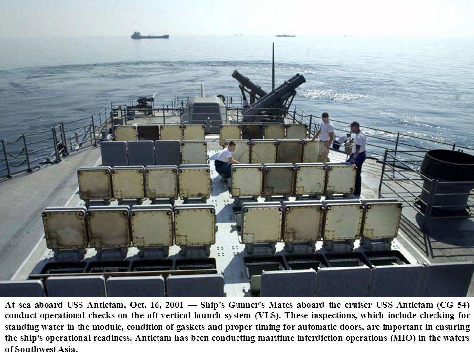 At sea aboard USS Antietam, Oct. 16, 2001 Ship's Gunner's Mates aboard the cruiser USS Antietam (CG 54) conduct operational checks on the aft vertical