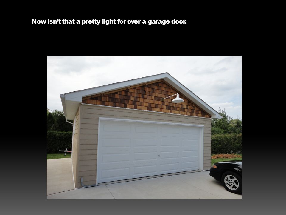 Now isnt that a pretty light for over a garage door.