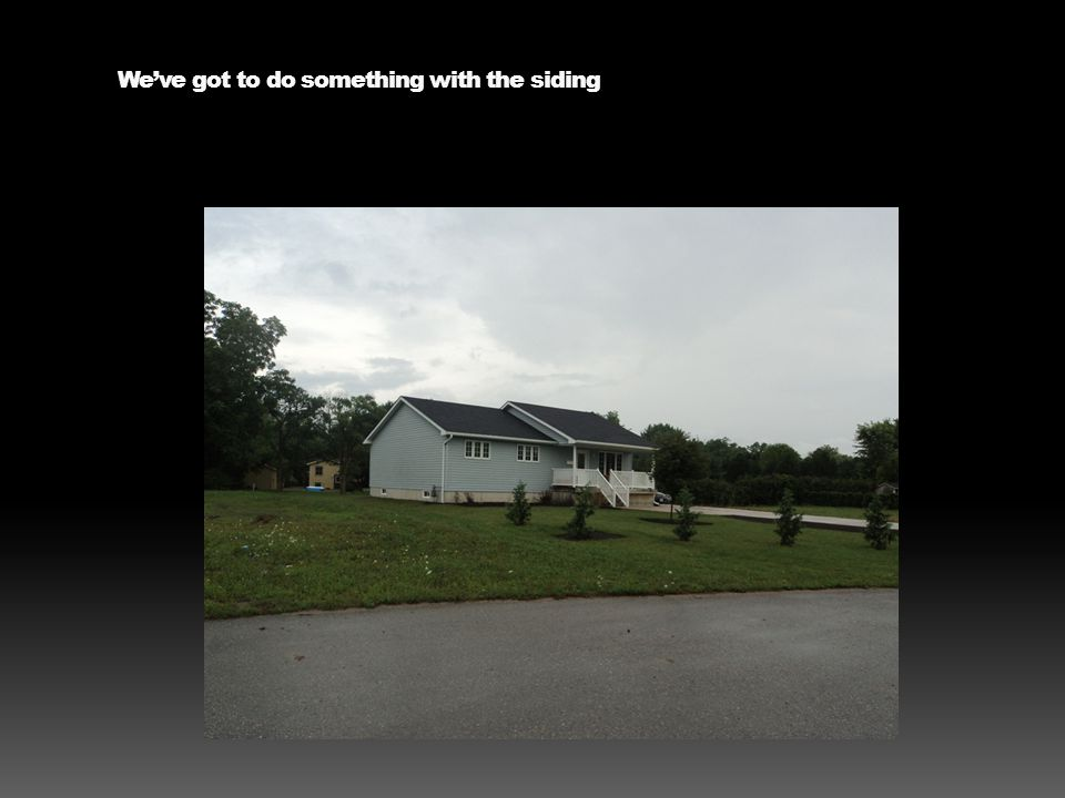 It has potential but do something – hate that gable vent and why does the eavestrough empty out onto the driveway.