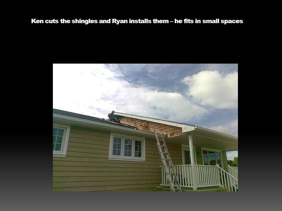 The base of the front porch is stained a darker shade than the siding to visually pull it down.
