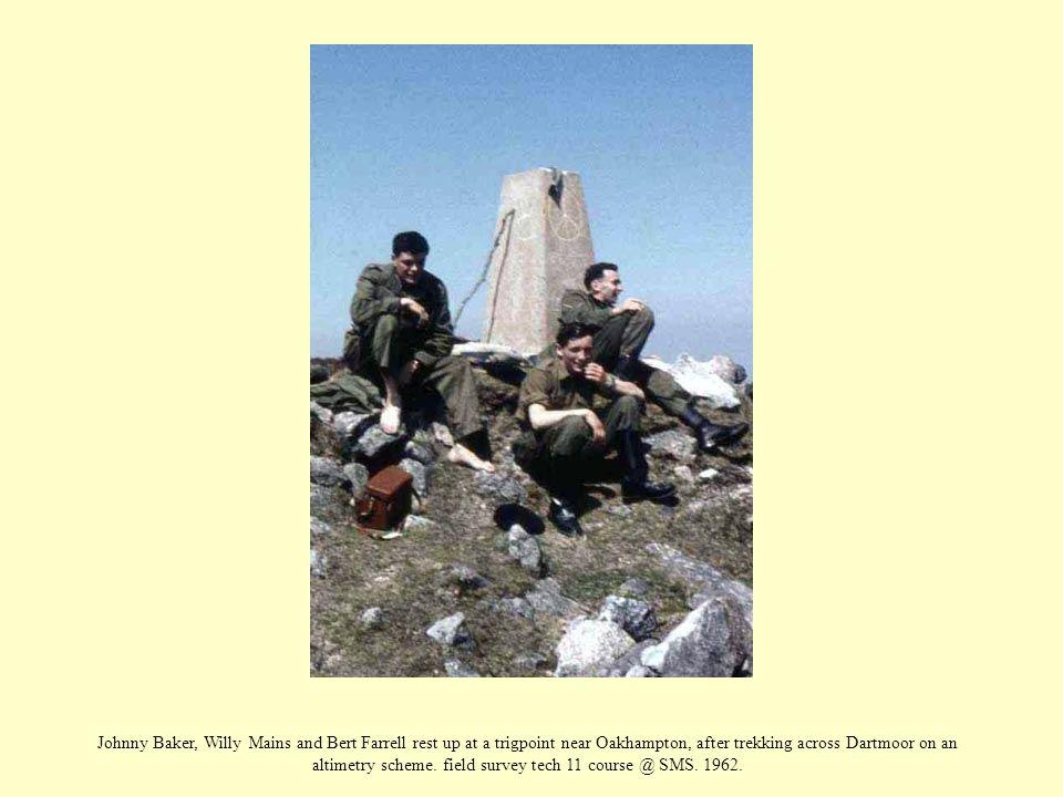 Johnny Baker, Willy Mains and Bert Farrell rest up at a trigpoint near Oakhampton, after trekking across Dartmoor on an altimetry scheme.
