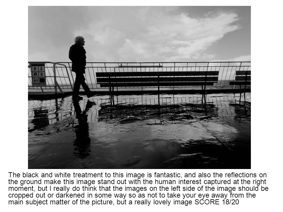 The black and white treatment to this image is fantastic, and also the reflections on the ground make this image stand out with the human interest cap