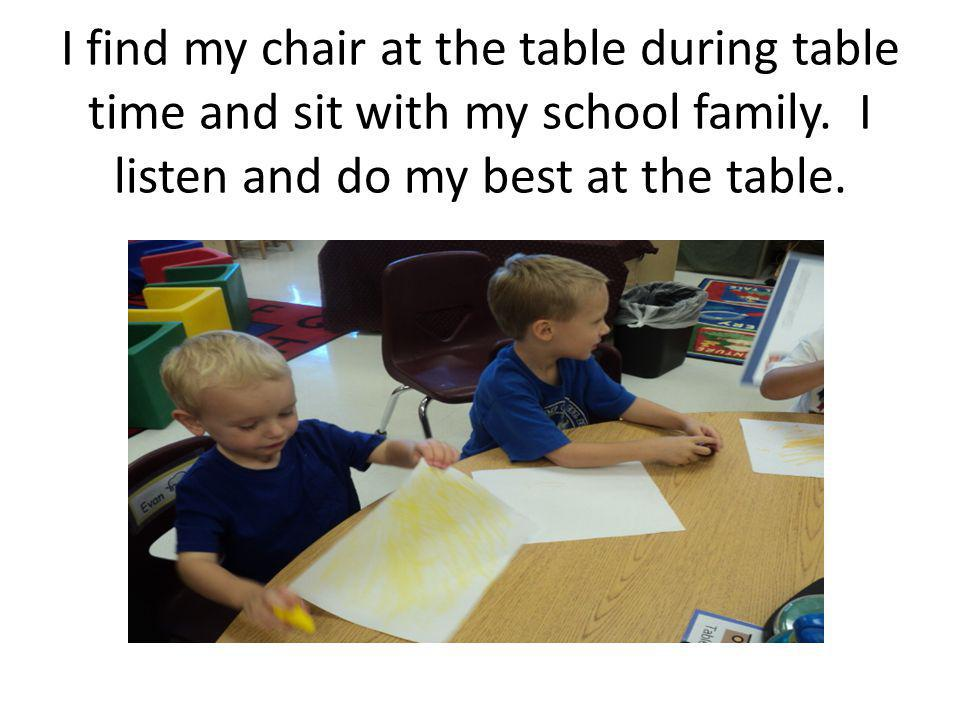 I find my chair at the table during table time and sit with my school family.