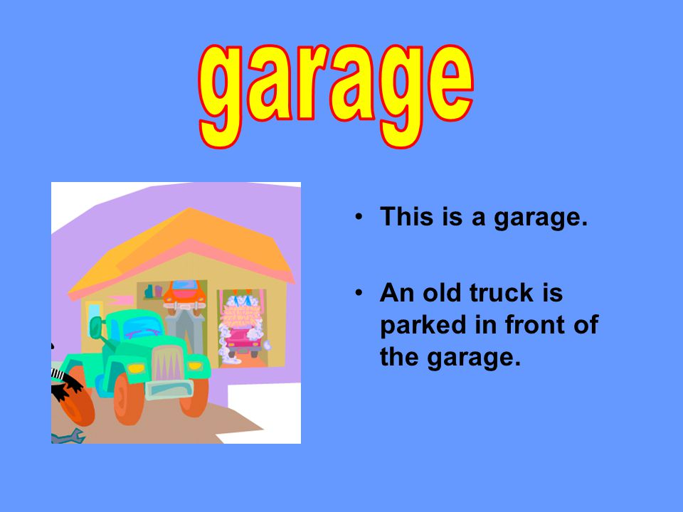 This is a garage. An old truck is parked in front of the garage.