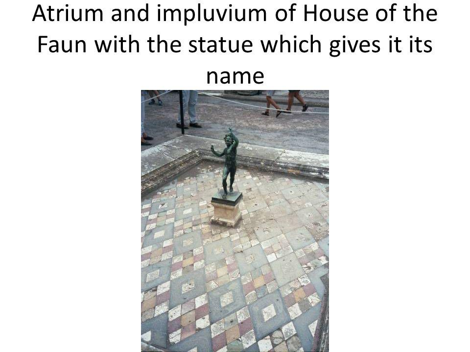 Atrium and impluvium of House of the Faun with the statue which gives it its name