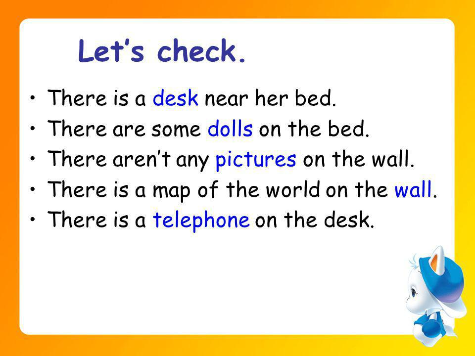Lets check. There is a desk near her bed. There are some dolls on the bed.