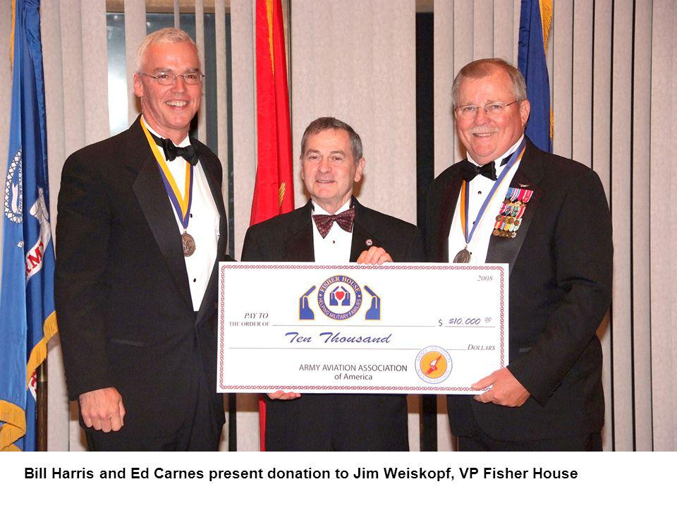 Bill Harris and Ed Carnes present donation to Jim Weiskopf, VP Fisher House