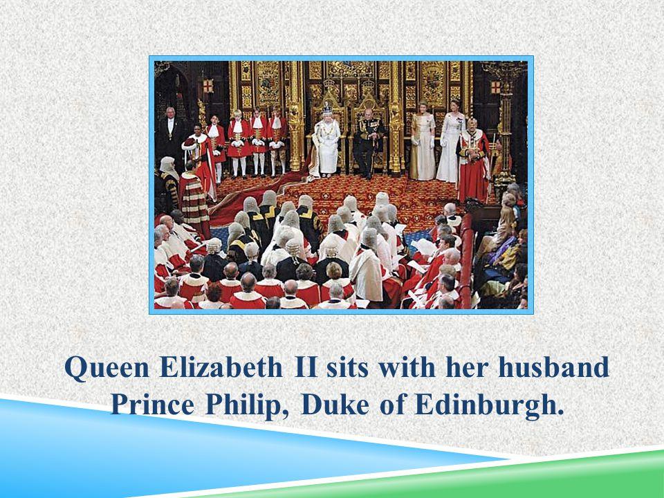 Queen Elizabeth II sits with her husband Prince Philip, Duke of Edinburgh.
