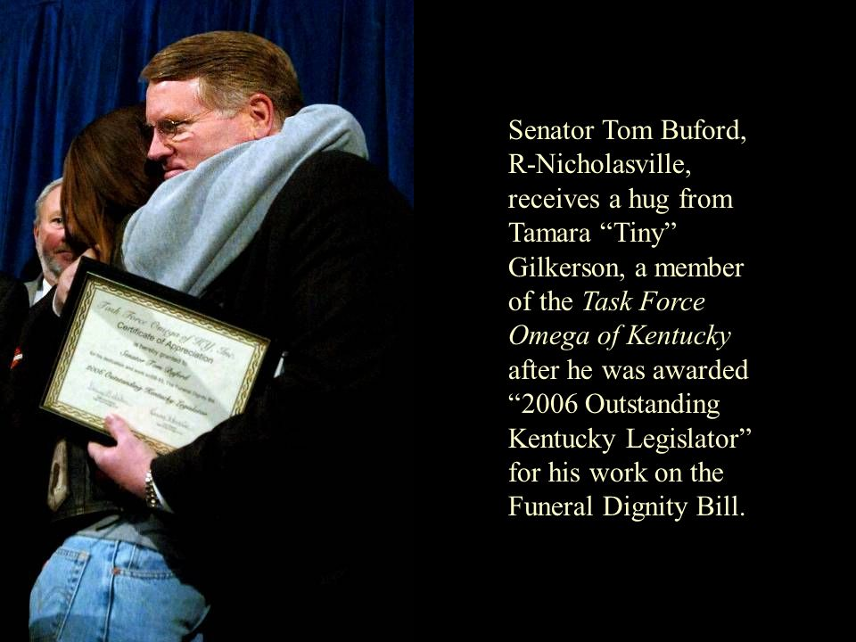 Senator Tom Buford, R-Nicholasville, receives a hug from Tamara Tiny Gilkerson, a member of the Task Force Omega of Kentucky after he was awarded 2006