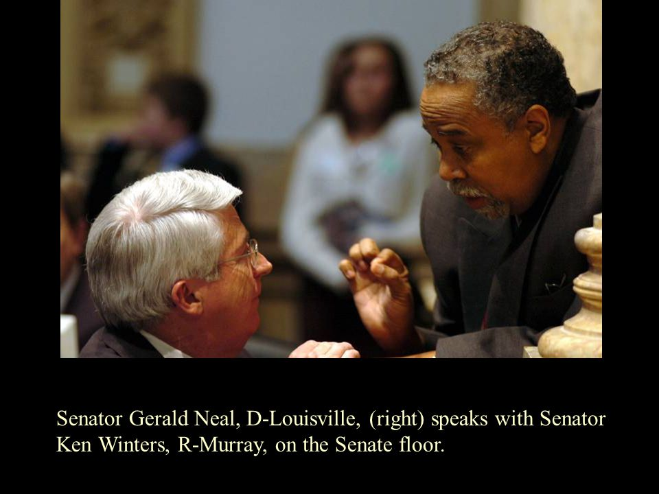 Senator Gerald Neal, D-Louisville, (right) speaks with Senator Ken Winters, R-Murray, on the Senate floor.
