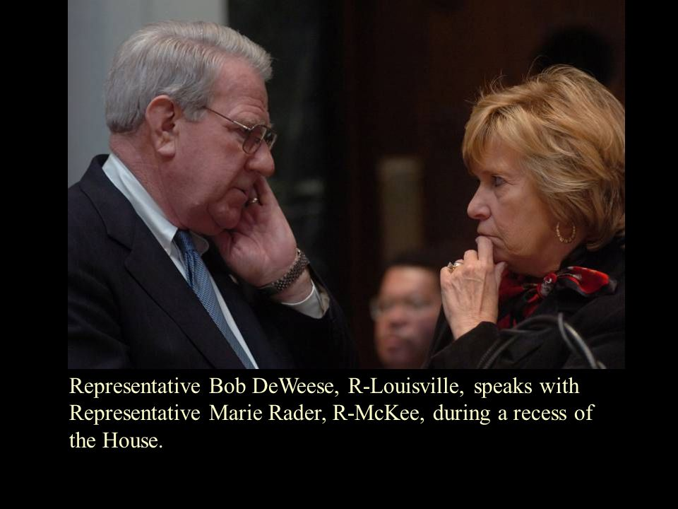 Representative Bob DeWeese, R-Louisville, speaks with Representative Marie Rader, R-McKee, during a recess of the House.