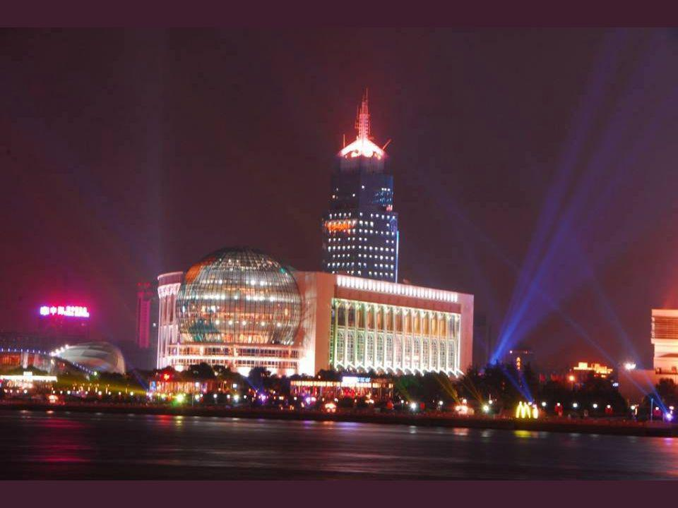Pudong ( ), across the Huangpu River ( ) from the Bund