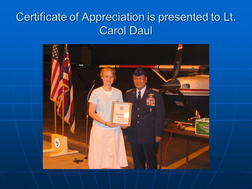 Certificate of Appreciation is presented to Lt. Carol Daul
