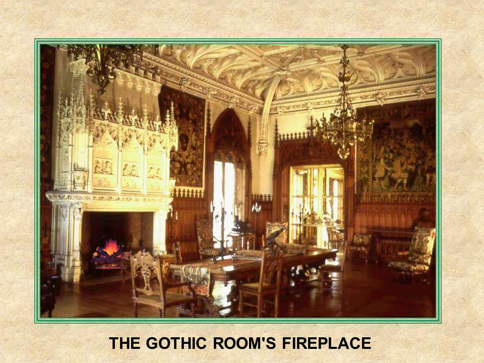 THE GOTHIC ROOM HAS COLORED STAINED WINDOWS AND A VERY ELABORATE CEILING.