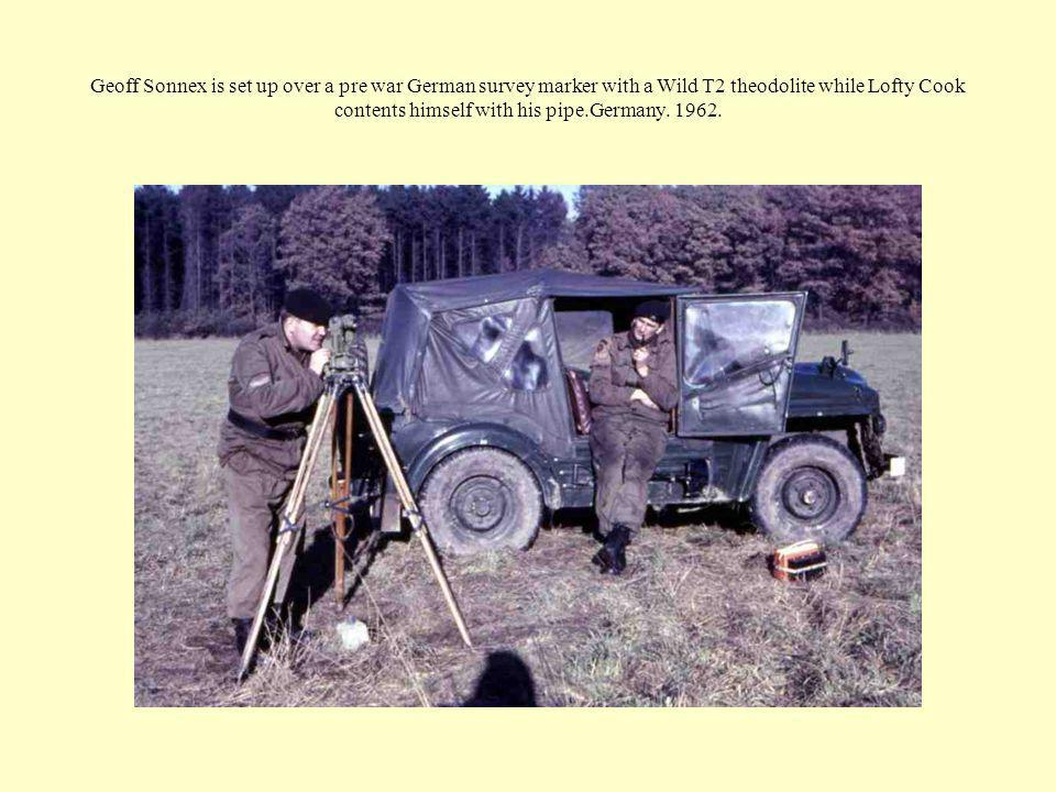 Geoff Sonnex is set up over a pre war German survey marker with a Wild T2 theodolite while Lofty Cook contents himself with his pipe.Germany. 1962.