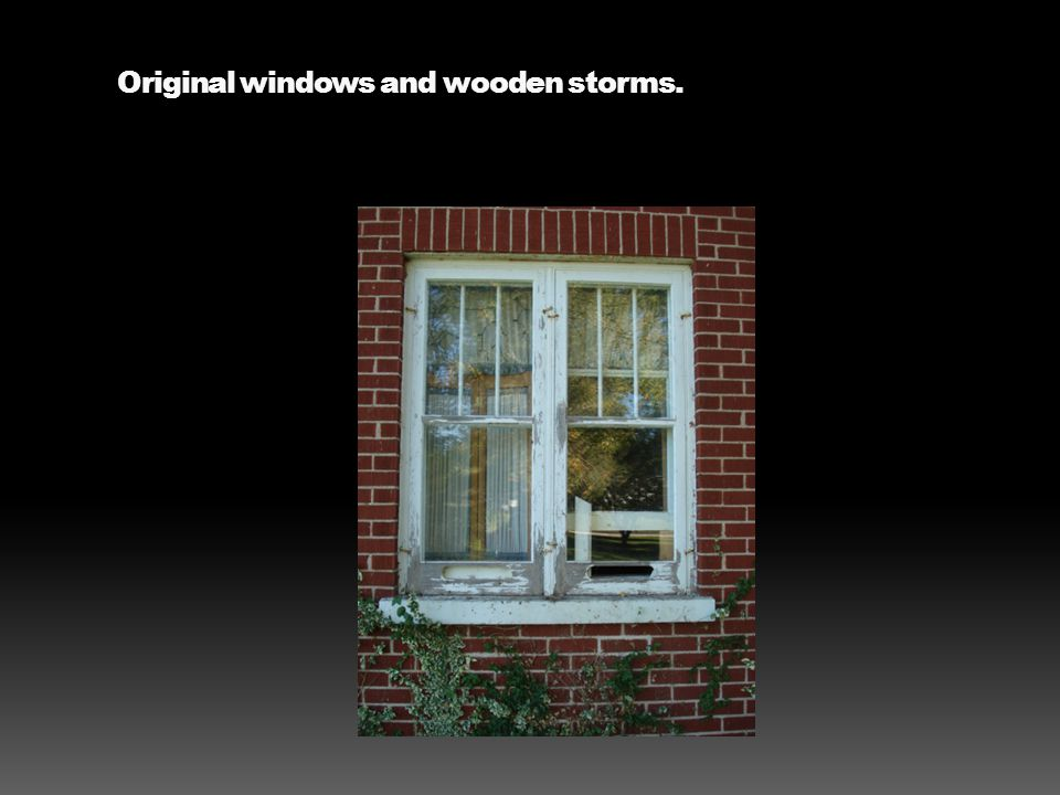 Original windows and wooden storms.