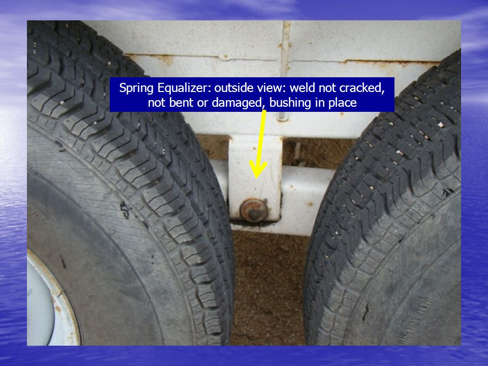 Spring Equalizer: outside view: weld not cracked, not bent or damaged, bushing in place