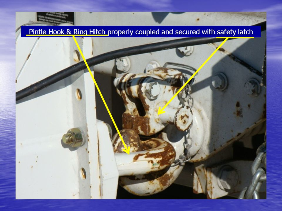 Pintle Hook & Ring Hitch properly coupled and secured with safety latch
