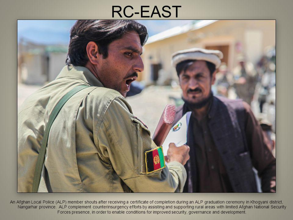RC-EAST An Afghan Local Police (ALP) member shouts after receiving a certificate of completion during an ALP graduation ceremony in Khogyani district, Nangarhar province.